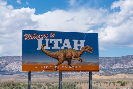 DINOSAUR, UT - JUNE 22, 2018: Welcome to Utah state border sign along route 40 along the Colorado-Utah border