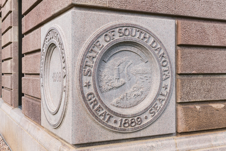 PIERRE, SD - JULY 9, 2018: State Seal of South Dakota on the cornerstone of the Capital Building in Pierre, SD Editorial
