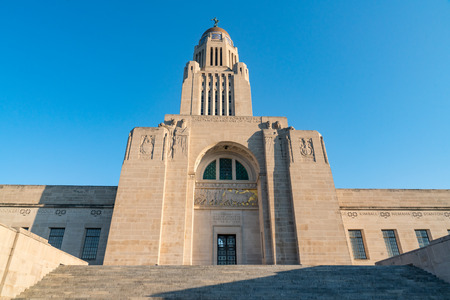 Exterior of the Nebraska Capitol Building in Lincoln against a blue sky