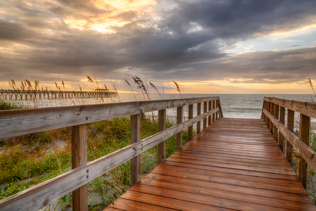 Sunrise along boardwalk over a sand dune in Myrtle Beach, South Carolina
