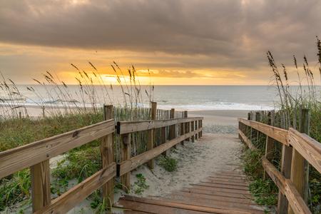 Sunrise along boardwalk over a sand dune in Myrtle Beach, South Carolina Stock Photo