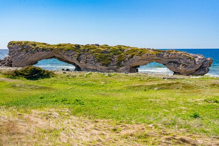 Arches along the coast of the Gulf of St Lawrence in Arches Provincial Park in Newfoundland, Canada