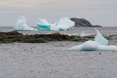 Icebergs in a cove along the coast of Newfoundland Stock fotó