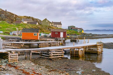 Boats and sheds in coastal fishing village in Newfoundland, Canada