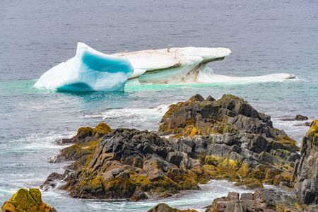 Iceberg floating in the ocean off the coast of Newfoundland, Canada