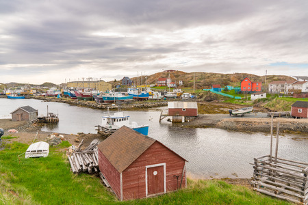 Jenkins Cove, Newfoundland - June 13, 2019: Boats and sheds in the harbor of Farmers Arm near Jenkins Cove, Newfoundland, Canada