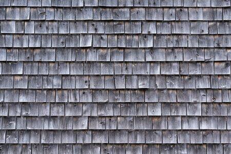 Exterior of a weathered gray cedar shingle wall
