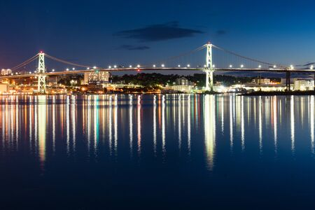 Angus L MacDonald Bridge at night which connects Dartmouth to Halifax, Nova Scotia, Canada