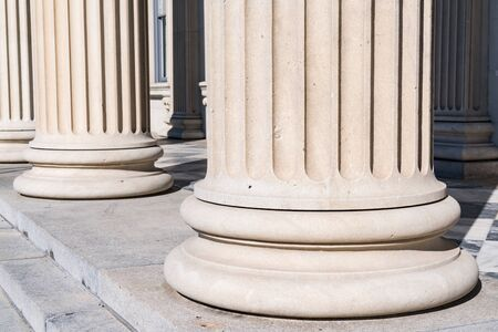 Based Detail of Fluted Greek Stone Columns Stock Photo