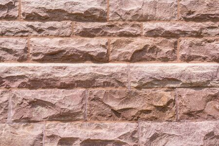 Granite block wall background on building facade