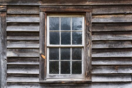 Exterior of old weathered window on rustic building