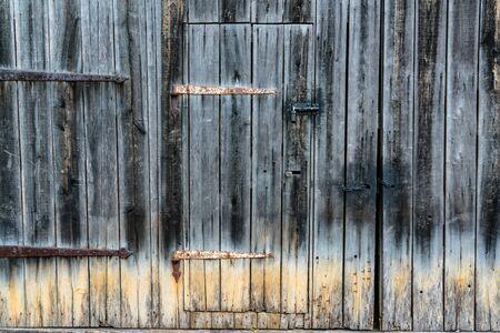 Old vintage, rustic weathered barn door