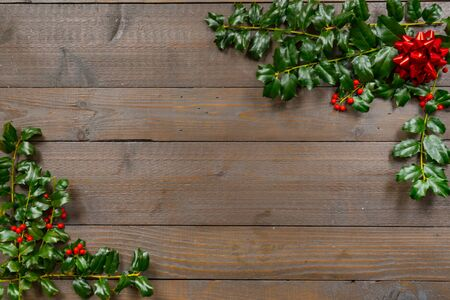 Christmas holly with Berries on a wood background 스톡 콘텐츠