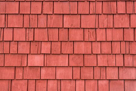 Exterior wall with bright red shingles
