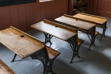 Desks lined up in an old one room school house