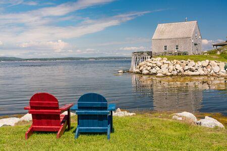 Adirondack chairs along the ocean near Peggys Cove, Nova Scotia, Canada