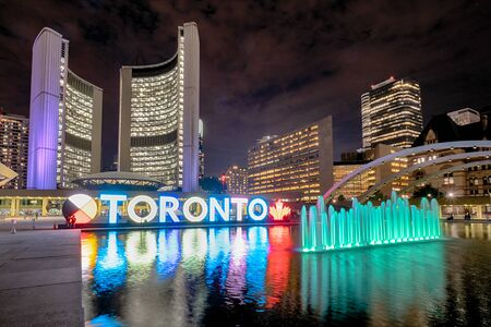 Toronto, Canada - September 20, 2019: Nathan Phillips Square at night with Toronto Sign and City Hall Building
