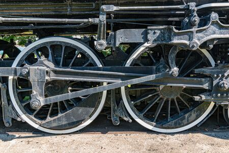 Old iron steam locomotive wheels and machinery