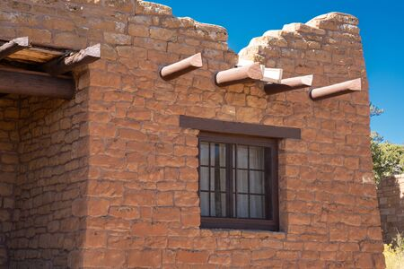 Windows and vigas in southwestern Stone building Stock Photo