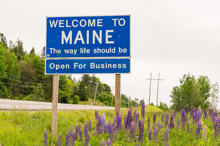 MAINE  USA - June 20, 2019: Welcome to Maine  - The Way Life Should Be sign at the state border