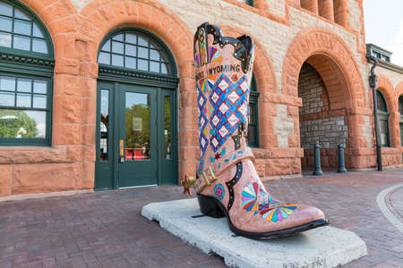 Cheyenne, WY - August 8, 2020: Large cowboy boot art sculpture outside of the historic Union Pacific Depot train station in Cheyenne, Wyoming