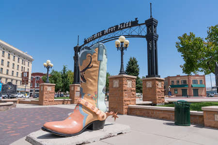 Cheyenne, WY - August 8, 2020: Large cowboy boot art sculpture outside in the historic Cheyenne Depot Park in downtown Cheyenne, Wyoming