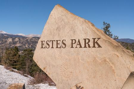 Estes Park, CO - November 29, 2020: Stone monolith sign on the border of Estes Park along route 36
