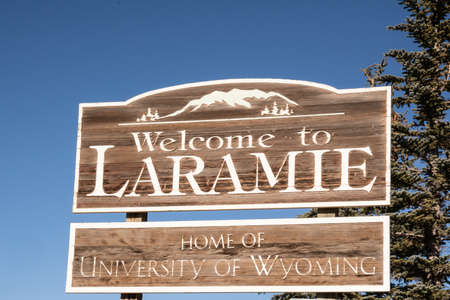 Laramie, WY - December 5, 2020:  Welcome to Laramie - Home of the University of Wyoming along route 287.