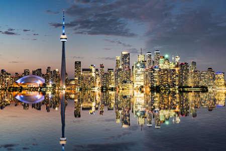 Reflection of the night city skyline of Toronto, Ontario, Canada