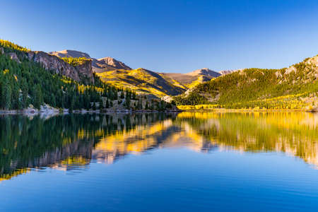 Reflection of aspen trees on Lake San Cristobal in the San Juan Mountains of Colorado