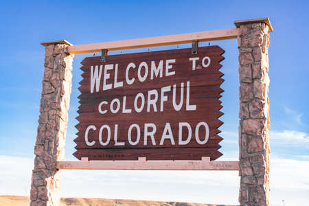 Welcome to colorful Colorado sign along the Colorado and Wyoming state border.