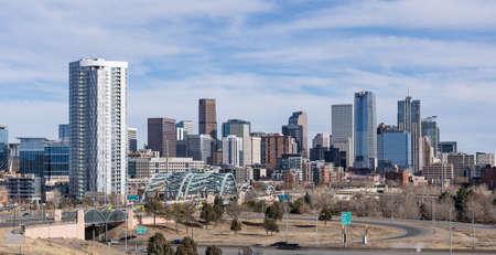 City skyline of Denver, Colorado along the South Platte River near the Speer Blvd bridge
