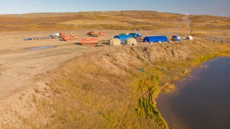 Field geological camp, in the middle of the tundra, with tents and drilling rigs. tundra