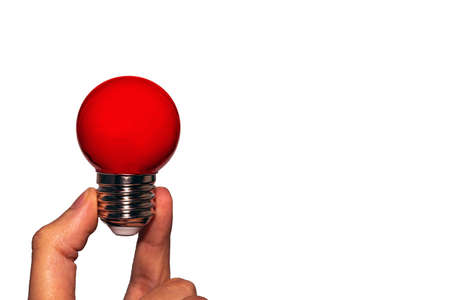 Great idea, the concept of a round Eletric red lamp in your hand. Isolate on a white background. Electric led red light bulb