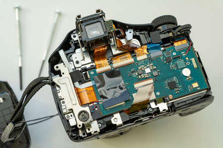 digital camera with the back cover removed. Circuits and cables of the camera