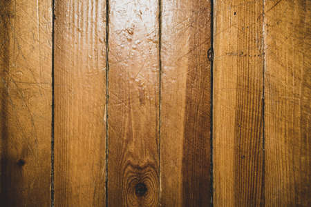 Texture and background of wooden boards. The background is made of old ones with a peeling lacquer coating.