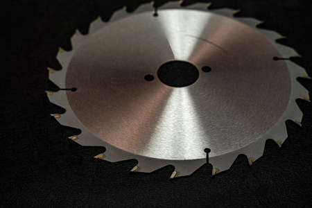 Circular saw blade, for sawing wood, with sharp sharpened teeth. Stock Photo