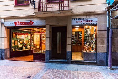 Bilbao, Spain, 190916. The facades of the haberdashery Bilboturas Merceria and the drugstore Droguería Juan Torre Perfumeria on street Artekale.