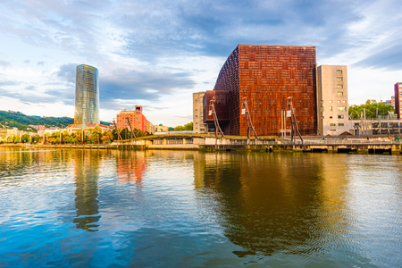 15/09-19, Bilbao, Spain. Euskalduna Conference Centre and Concert Hall to the right and the 165 m tall Iberdrola Tower to the left. Editorial