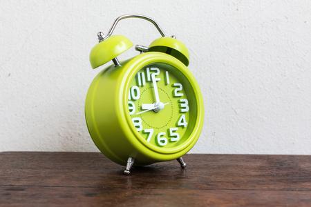 o'clock: Alarm Clock at 9 Oclock on wood table