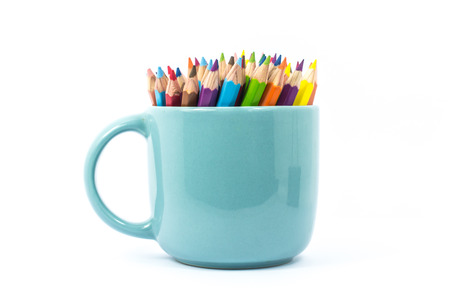 red pencil: Color pencil in the cup on white background Stock Photo