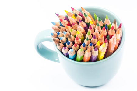 Color pencil in the cup on white background photo