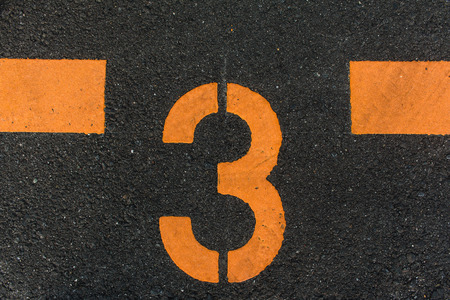 count down: the Number 3 Printed On The Road Stock Photo