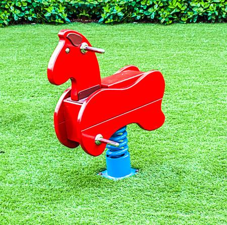 rocking: Red Rocking Horse on Yard Stock Photo
