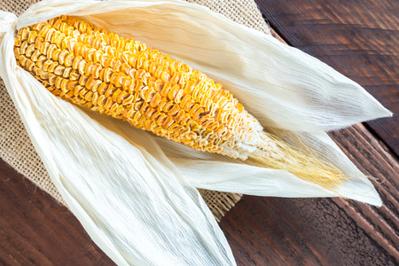 gunny: corn dry on gunny and wood table Stock Photo