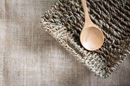 gunny: spoon wood in basket on gunny