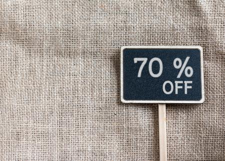 70: sale 70 percent off drawing on blackboard
