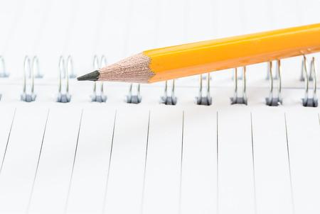 closeup pencil on notebook photo