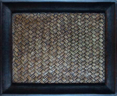 wicker bar: Zigzag interlocking of handcraft bamboo weave texture natural wicker background in wood frame