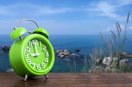 hillock: Clock on Wooden Floor with Blue Sky and Hillock  Background Stock Photo